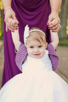 Flower girl in a cute dress and purple shrug.