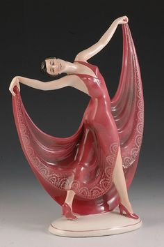 Art deco (?) statue of women in red gown