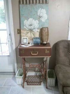 Old sewing machine stand & old suitcase - great table idea!