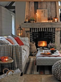 For a casual, comfy feel, choose cushions and a footstool in weaves and designs inspired by far-flung places, which sit beautifully with a country-style sofa and rustic fireplace.