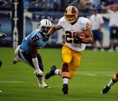 Roy Helu #29 of the Washington Redskins runs past Zach Brown #55 of the Tennessee Titans during a pre-season game at LP Field on August 8, 2013 in Nashville, Tennessee. (Photo by Frederick Breedon/Getty Images)