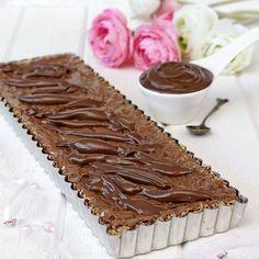 Nutellakladdkaka med kokosbotten och smält choklad