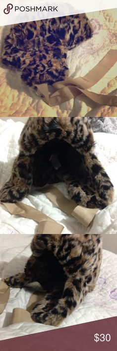 """Juicy Couture Leopard Hat This leopard-print faux fur trapper hat features canvas ties at the earflaps. 5"""" crown. Sateen lining. NEW. Never worn. ‼️  * 100% acrylic. * Spot clean. * Imported. Juicy Couture Accessories Hats"""