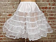 CAN CAN SLIP...I remember when we used to wear 4-8 of these at a time as well as a big hoop petticoat ...depending on the dress or skirt were  wearing.  It was fun trying to fit in our desks.