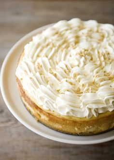 Maple Cheesecake - This maple cheesecake is a nice departure from the pumpkin cheesecake that graces most Thanksgiving tables.  No doubt, pumpkin cheesecake is delicious, but this maple version is truly something special. #dessert #pie #cake
