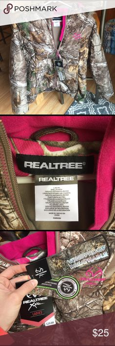 Realtree camo coat with pink. Large. New with tags Realtree Xtra women's coat. Camo with pink accents and pink camo hood. Fur lined hood. Size Large. New with tags, never worn. Realtree Jackets & Coats