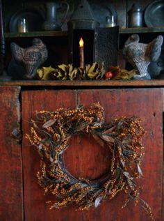 Prim Autumn...turkey molds, wreath & candlelight.