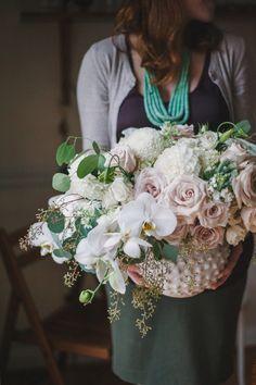 Elegant centerpiece: http://www.stylemepretty.com/living/2015/03/12/25-pretty-vases-for-spring/