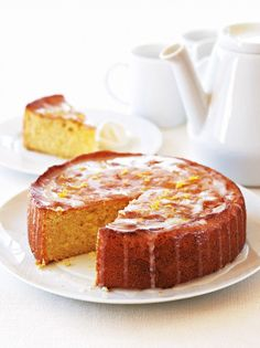 Try our lemon drizzle cake recipe. This easy lemon cake recipe is an easy round lemon drizzle cake recipe. Make our easy and moist lemon drizzle cake recipe Orange Drizzle Cake, Lemon Recipes, Sweet Recipes, Cake Recipes, Olive Recipes, Salty Cake, Cake Ingredients, Cake Tins, Gastronomia