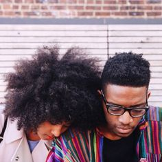 His and her texture. His and her curly afro. Kinky curly hair. Afro hair. Afro curly frizz, a beautiful combination. Tight curls and coils.