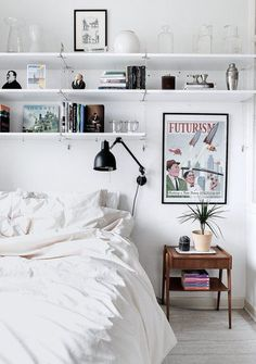 casual bedroom | home, interior, white, shelving, bedding, vintage poster, lamp, storage