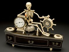 Skeleton Alarm Clock Goes on Display in London. An alarm clock currently on view at the British Library in London, which is part of the Terror and Wonder: The Gothic Imagination exhibition, is a curious continuation of the memento mori tradition. Momento Mori, Museum Displays, Science Museum, British Library, Coffin, Creepy, Scary, Death, Social Media