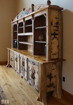 Rustic alder bookcase with bark and twigwork