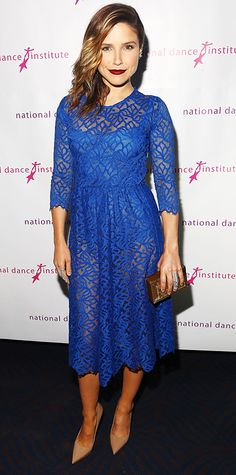 Sophia Bush went for an ultra-sexy look with a sheer cobalt blue lace dress with a matching bodysuit underneath, both by For Love & Lemons, amping up her look even further with Jacob & Co. ear cuffs and armor rings, a metallic Rauwolf clutch, and nude Kurt Geiger pumps.