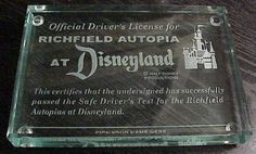 Disneyland Autopia glass paperweight drivers license.