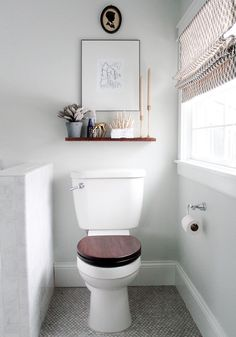 Floating wood shelf and wood toilet seat.  For more decor ideas go to: http://www.villa-candles.com/newblog1/