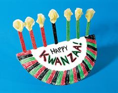 Turn a paper plate and craft sticks into a fun kinara for Kwanzaa. A great project for kids of all.Shared by Career Path Design. Holiday Crafts For Kids, Family Crafts, Holiday Themes, Holiday Traditions, Christmas Activities, Holiday Fun, Christmas Crafts, Holiday Ideas, Hanukkah Crafts