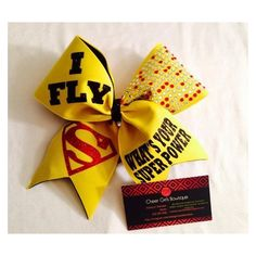 Items similar to Superman Cheer Bow-- I Fly or I Cheer Superman Hair... ❤ liked on Polyvore featuring accessories, hair accessories, hair bows and hair bow accessories
