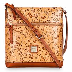 Lovebirds Bag Mickey and Minnie Mouse show their affection on this spacious letter carrier by Dooney & Bourke. Featuring burnished leather and textured design, this fine fashion bag will let you bring Disney's lovebirds wherever you go. Dooney And Bourke Disney, Disney Dooney, Dooney Bourke, Minnie Mouse Show, Mickey Mouse, Disney Handbags, Disney Purse, Style Disney, Disney Outfits