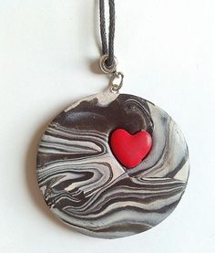 Black and white polymer clay swirled zebra print necklace with red heart by KaisCards, £7.00
