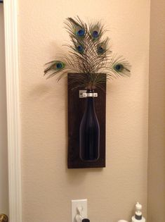 Wine bottle wall decor but because my bathroom is peacock theme I added feathers