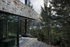 A floating fireplace feels appropriate for a sleek cliffside cabin that seems to defy gravity. Source