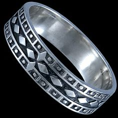 Silver ring, band Silver ring, Ag 925/1000 - sterling silver. A band with relief geometric shapes.