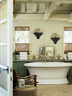 Cottage Charm- Over the years, this master bath had lost its vintage charm. Reclaiming it was the goal of a recent remodel. Now the cottage look is back, accomplished with an outdoor-oriented scheme where colors of sea and shore, along with beachy accessories, set the stage for a centerpiece soaking tub.