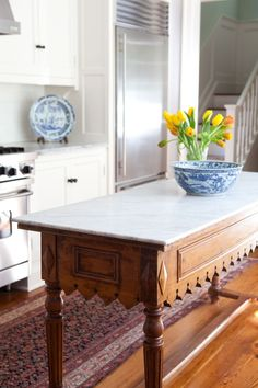 Antique buffet table reimagined with a marble slab top and repurposed as kitchen island. Brilliant! || Return on Interiors®
