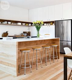 I like the white with the island in wood tone with apron on each side to emphasize the wood of the island MDK