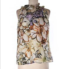 Etcetera silk floral blouse Etcetera silk floral blouse. 100% silk. Dry clean only. Brigh floral pattern .  Bust is 40 in. Length is 24 in. New without tags. No flaws or signs of wear. Ships within one week. Etcetera Tops Blouses