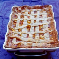 Though not a true cobbler, this large rectangular peach pie, with its cream cheese crust, is a great way to serve summer dessert to a crowd.