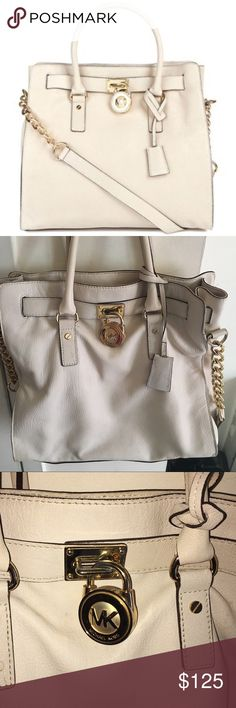 Michael Kors Handbag Creme, leather handbag with gold detail. This is a perfect summer bag! This was only worn a few times but shows some wear seeing it's not as straight and structured as the stock photo. This will last a lifetime with proper care! No holes or scratches. Michael Kors Bags Totes