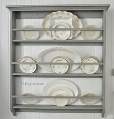 Shallow plate storage for a big, statement wall. Same idea for use ...