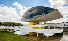 Oscar Niemeyer Museum Annex - Front Exterior - This addition to the museum of visual arts, architecture and design was originally called the Novo Museu (new museum), but it was eventually renamed after the architect. Brazil Tourism, Brazil Travel, Great Places, Beautiful Places, Nice View, Vacation Spots, Exterior, Tours, Parks