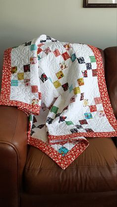 One of a kind, handmade, hand quilted, 100% GOTS Certified organic cotton. A colorful (reds, blues, gold, greens, and browns) baby/transition quilt that is a generous 39 x 51 in size. Perfect for your baby or that special gift that will never be forgotten. This quilt comes with its own storage pillowcase trimmed to match (monogramming available). It is perfect for use in the crib, as a stroller cover, car seat blanket, a throw while watching Disney or just relaxing belly time with Mom an...