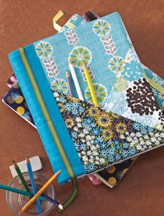 Cover a plain sketchbook with bright, fun fabric prints and add tons of pockets to hold pens and notes. Great for all ages! Get the templates FREE from Sew it All!