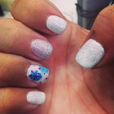 Christmas snowflake nail art. Blue, teal, white, purple, and silver. Let it snow! Love them!
