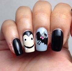These cute DIY Dracula nails are perfect for Halloween.