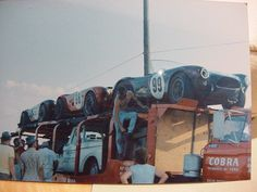 Ford Cobra race cars on a delivery truck. Mustang Cobra, Ac Cobra, Shelby Mustang, Ford Mustang, Shelby Car, Classic Race Cars, Car Trailer, Trailers, Car Carrier