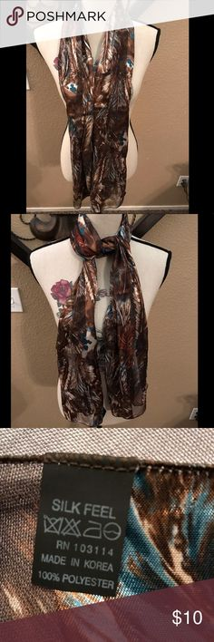 brown with feathers scarf NWOT 100% polyester- silk feel- brown with feathers scarf New with out tag Accessories Scarves & Wraps