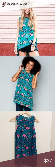 Show Me Your Mumu Sherman Printed Tunic Tank SMYM Printed Tunic Tank • Baby Buds floral pattern • dress it up or wear it casually NOTE: has tiny run in chest area (see photos 6 and 7). Visible when held up to light and up close, but someone would really have to be looking for it to notice- nearly undetectable to the wandering eye • pet and smoke free • measurements upon request Thanks for looking and happy shopping 🥂 Show Me Your MuMu Tops Tank Tops