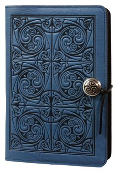 Leather journals, handmade by Oberon Design, in the U.S. A. Refillable covers available in a large variety of sizes, images & colors. Triskellion Knot.