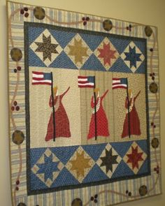 Love the Patriotic Theme! I like the Statue of Liberty ladies and the stars on point, but I think the appliqued border detracts from the quilt design overall.