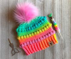 Bubblegum Pop Beanie is a very fast beanie made from the bottom up. It stands out especially when made with Red Heart Super Saver Stripes yarn.