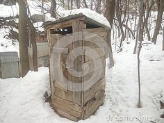 Old toilet surrounded by white snow