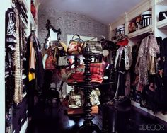 Fashion star Anna Sui's second Manhattan apartment—a top-floor space in the same building as her one-bedroom home—has a stylish dressing room to hold the overflow from her wardrobe. Custom shelves were designed to fit her many shoe boxes, which are labeled with Polaroids of their contents. Striped hooks offer a perch for to protect delicate sequined items from getting crushed.