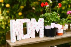For a Mother's Day Meal,we love these cardboard letters (from any craft store) covered in cute scrapbook paper! #mothersday