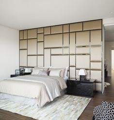 Fabric covered wall / panels create really interesting contemporary feature wall #hospitalitydesign #headboard