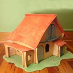 This wonderful wooden play house for kids is made by a German toy company called Holzkram, and for sale on a great webshop - Quiet Hours Toys. They sell a couple of other houses, wooden animals, families and trees (see. Woodworking Workshop, Custom Woodworking, Woodworking Projects Plans, Teds Woodworking, Kids Doll House, Wooden Dollhouse, Dollhouse Ideas, Wooden Dolls, Wooden Playhouse